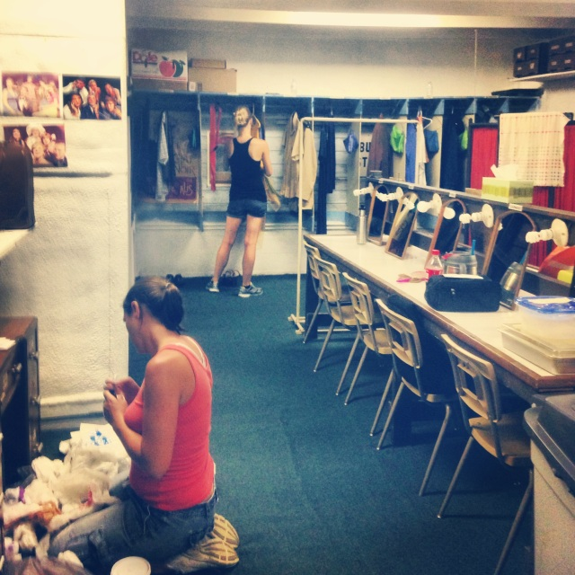 "Cleaning backstage after the close of ""Swan Song."""